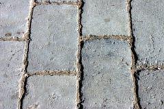 Ziegelstein-Straßenbetoniermaschinen als Hintergrund Lizenzfreies Stockfoto
