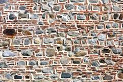 Ziegelstein und Steinwand. Stockbild