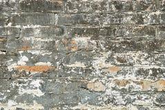 Ziegelsteinbeschaffenheit mit Kratzern und Sprüngen Lizenzfreies Stockfoto