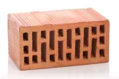 Ziegelsteine des roten Lehms auf weißem Hintergrund Lizenzfreie Stockfotos