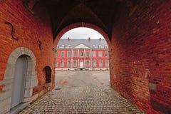 Ziegelsteintor zu Stavelot-Abtei an einem bewölkten Tag Lizenzfreies Stockfoto