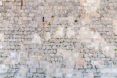 Ziehen Sie sich Wand wie Block und Steinmuster des mittelalterlichen Betons zurück Lizenzfreies Stockbild