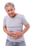 Zieke oude mens die aan maagpijn, diarree, indigestiep lijden Stock Foto's