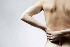 Ziekte van de gehouden rug en de kerel stock fotografie