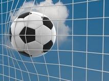 Ziel. ein Fußball in einem Netz. Stockfotografie
