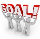 Ziel-Wort angehoben von der Cheerleader Team Hoping für Gewinn und Erfolg Stockbilder