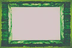 Zieleń stylizująca rocznik drewniana rama, zabarwiająca kosmos kopii zdjęcia royalty free