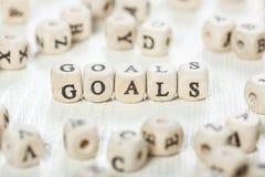Ziele fassen geschrieben auf hölzernen Block ab Stockfotos