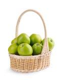 Zieleni jabłka w koszu na biel Fotografia Stock