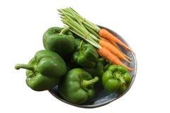 Zieleni pieprze i mała marchewka w garnku Zdjęcia Stock