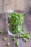 zieleni szkło grochy Zdjęcie Stock