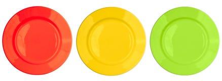 zielenieje odosobnionych talerzy czerwonego ustalonego odgórnego widok kolor żółty Fotografia Stock