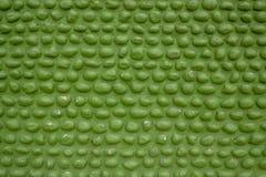 Zielona ściana owal brukuje kamienia kamieniarstwo Szorstka powierzchnia ściana Otoczak kamienna tekstura zdjęcia stock