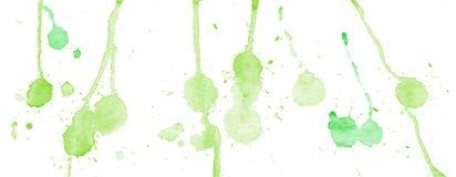 Zielona akwarela bryzga i zaplamia na białym tle Obrazy Royalty Free