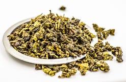 Zielona herbata na talerzu Obrazy Royalty Free