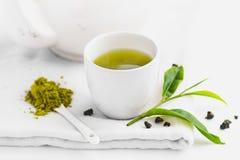 Zielona herbata W białej filiżanki tła Białym aromacie zdjęcie stock
