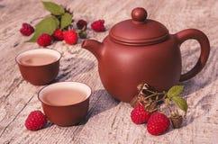 Zielona herbata z malinką zielona herbata Obrazy Stock
