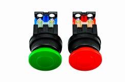 Zielona i czerwona pchnięcie guzika zmiana obrazy stock