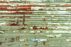 Zielona ośniedziała rolkowa żaluzja Zdjęcie Stock