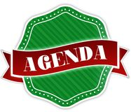 Zielona odznaka z agenda tekstem na czerwonym faborku Obraz Stock