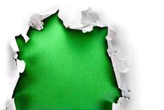 Zielona papierowa dziura. Obraz Stock