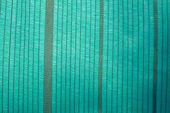Zielona plastikowa podcieniowanie sieć jako tło Zdjęcia Stock