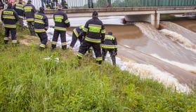 ZIELONA, POLAND - JUNE 11:Man from fire brigade make sandbank fr Royalty Free Stock Photography
