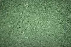 Zielona tło tekstura szorstki asfalt, odgórny widok Obrazy Stock