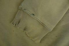 Zielona tkaniny tekstura z rękawem kawałek obdarty stary odziewa zdjęcie royalty free