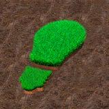 Zielona trawa w formie żarówki na glebowym tle, pojęciu ECO i energii odnawialnej, zdjęcia royalty free