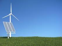 Zielona trawa z panelem słonecznym i wiatrowym generatorem Zdjęcie Stock