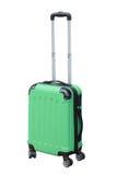 Zielona walizka na kołach dla podróży Zdjęcia Royalty Free