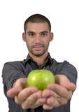 - zielone jabłka zdrowych ludzi młodych gospodarstwa kolego Obraz Stock