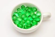 Zielone pigułki Fotografia Royalty Free