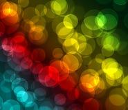 Zielonego czerwonego błękitnego koloru żółtego bokeh barwiony tło Obrazy Stock