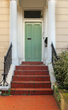Zielonego domu drzwi Zdjęcia Royalty Free