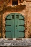 Zielonego domu drzwi w Malta Fotografia Stock