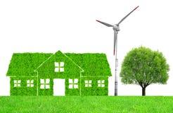 Zielonego domu symbol z silnikiem wiatrowym i drzewem Zdjęcia Royalty Free