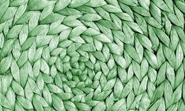 Zielonego koloru słomy maty powierzchnia z round wzorem Fotografia Royalty Free
