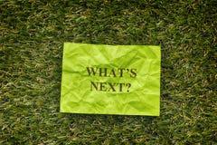 Zielonego papieru nutowy saying Co jest następny? zdjęcia royalty free