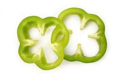 Zielonego pieprzu plasterek na białym tle Obrazy Royalty Free