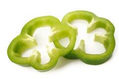 Zielonego pieprzu plasterek na bielu Fotografia Stock