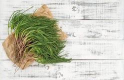 Zielonego warzywa agretti kuchennego stołu jedzenia drewniany tło Obrazy Royalty Free