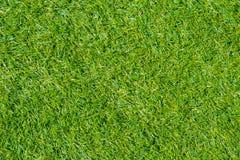 Zielonej trawy lub sztucznej trawy trawy plastikowy pole Fotografia Stock