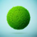 Zielonej trawy sfera na błękitnym jasnym tle Zdjęcie Stock