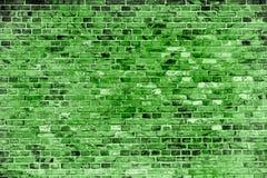 Zielony ściana z cegieł malował z różnymi brzmieniami i odcieniami zieleń jako bezszwowy deseniowy tekstury tło Obrazy Royalty Free