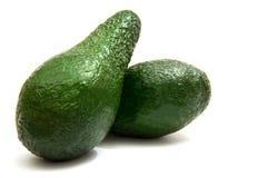 Zielony avocado ciie w przyrodnim lying on the beach na bia?ym tle obraz royalty free