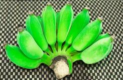 Zielony banan od ogródu w kostka do gry deseniuje tło Fotografia Royalty Free