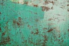 Zielony brązu tło od starego metalu barwił ścianę obraz stock