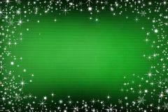 Zielony brezentowy tło z śniegiem i gwiazdami zdjęcia stock